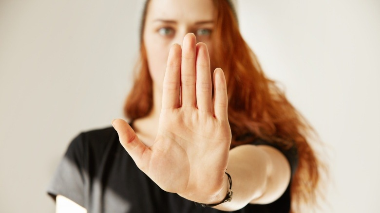 woman interrupting with hand up