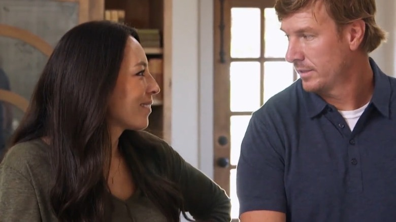 Chip and Joanna Gaines looking at each other lovingly