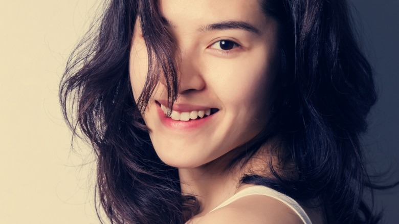 smiling woman hair in face