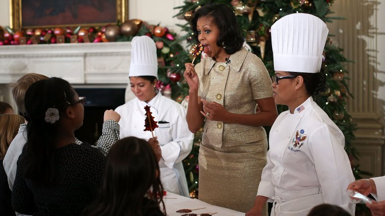 Michelle Obama eating dessert with White House chefs