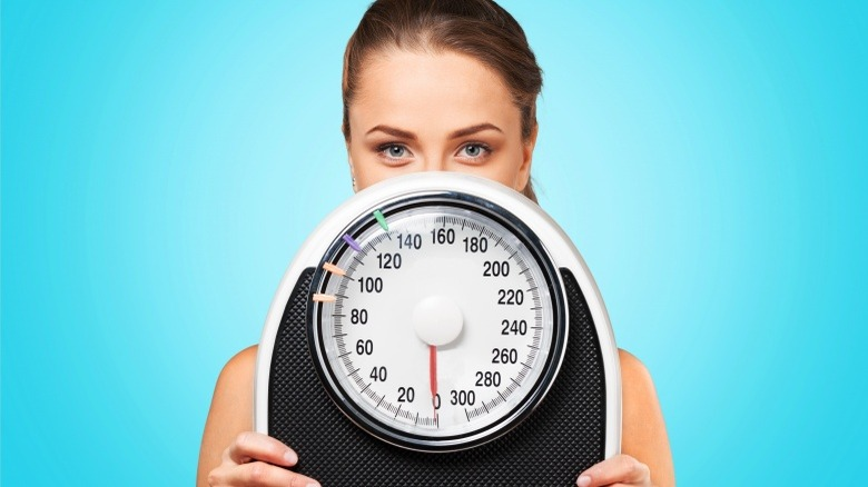 woman with scale weight loss