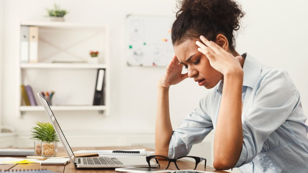 A stressed woman at her desk