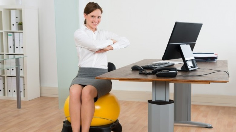 8 Exercises You Can Do While Sitting At Your Desk