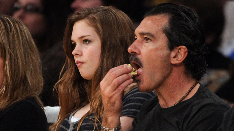 Antonio Banderas' daughter Stella with her father at a game