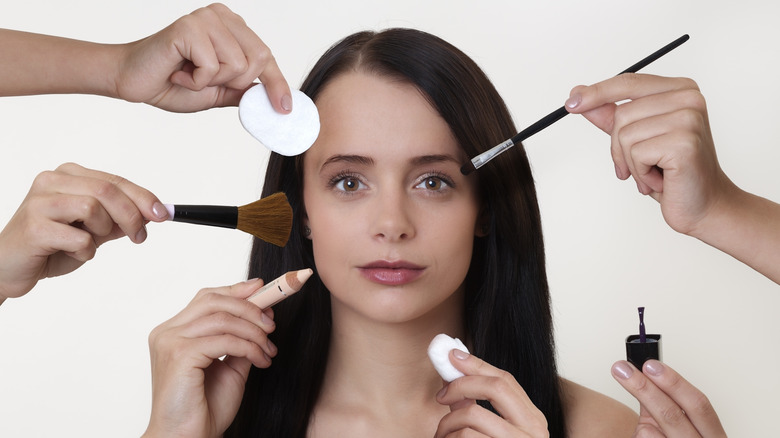 Woman getting makeup appiled