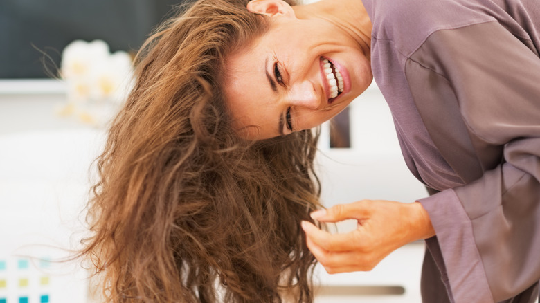 woman drying hair upside down