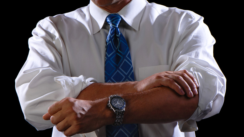 Man rolling up sleeves