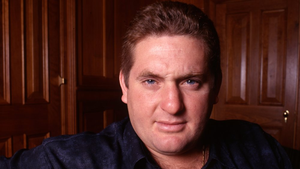 Chris Penn in front of a wooden wall