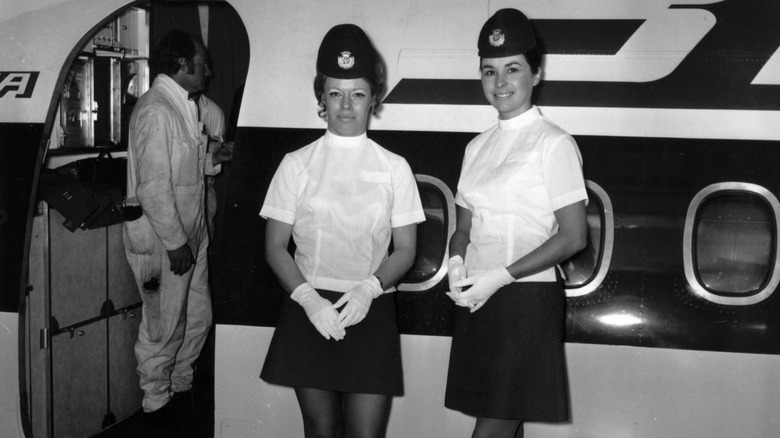 Flight attendants posing