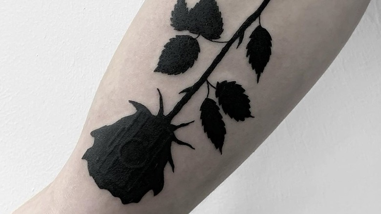 The Real Meaning Of A Black Rose Tattoo