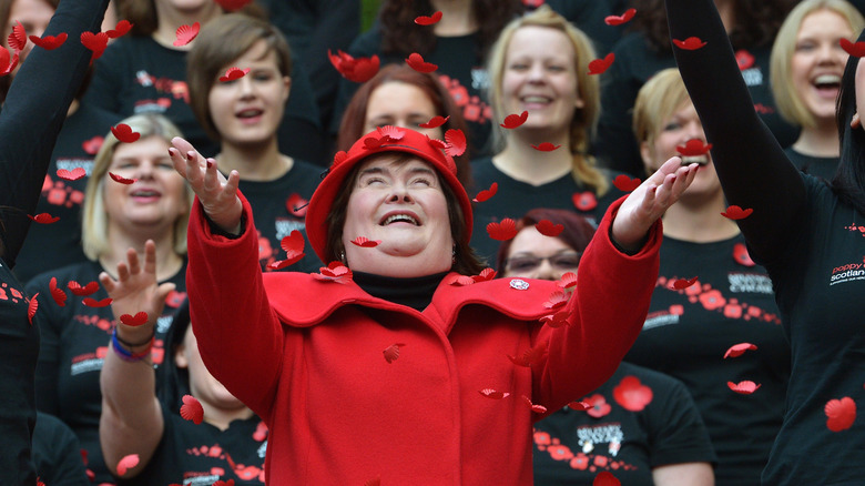 Susan Boyle with red flower petals