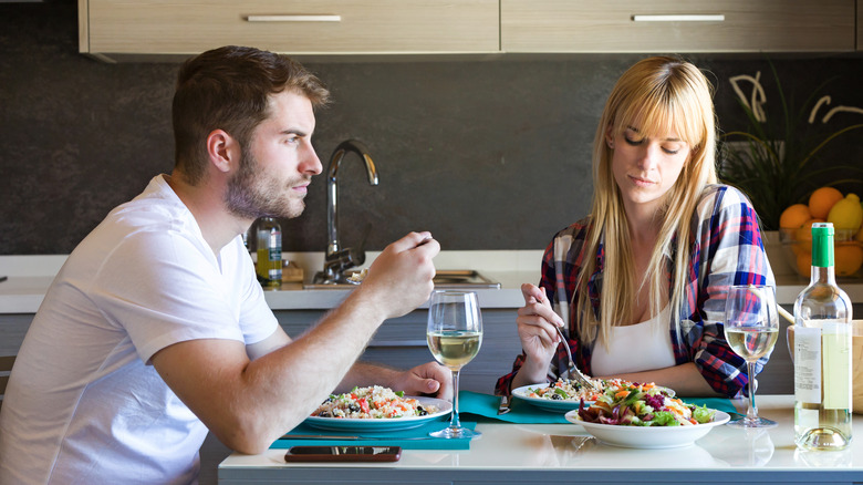 couple eating dinner without talking