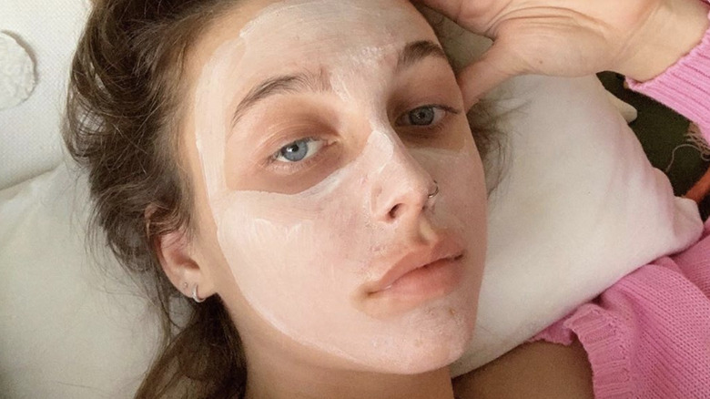 Emma Chamberlain with a face mask on