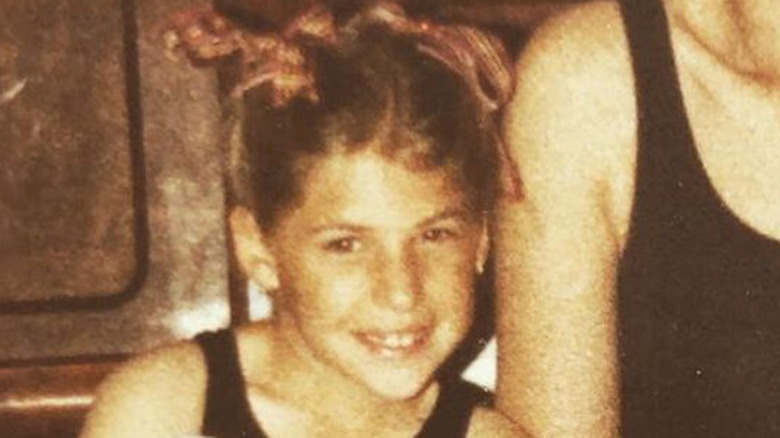 Mayim Bialik as a young girl with ribbons in her hair