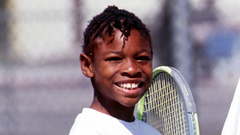 Serena Williams in 1991 with a tennis racket