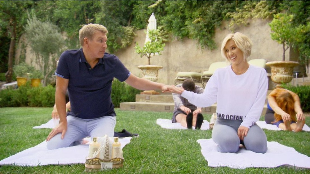 Todd and Savannah Chrisley in a yoga class