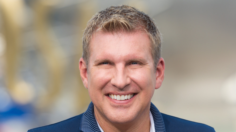 Todd Chrisley on the red carpet, smiling