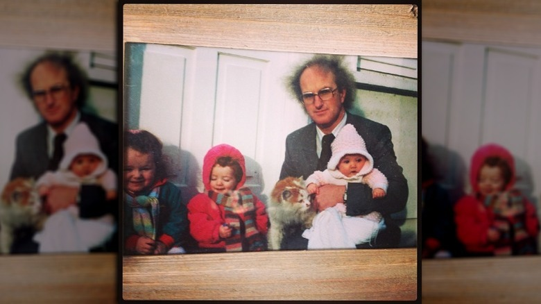 Evanna Lynch as a baby with father