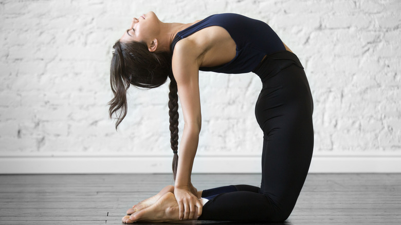 A woman doing yoga in camel pose