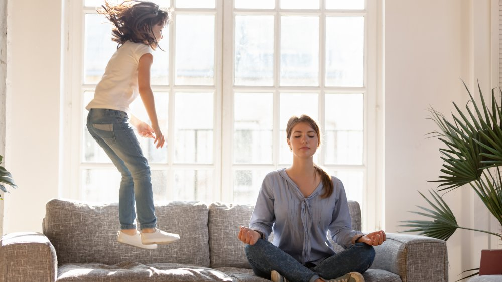 girl and mom meditating