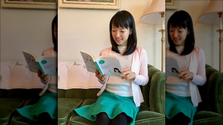 Marie Kondo reading her book at home