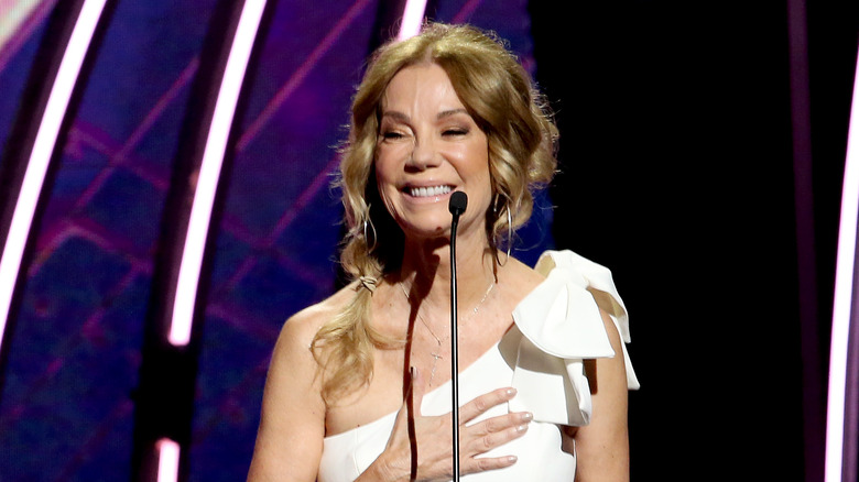 Kathie Lee Gifford standing at a microphone