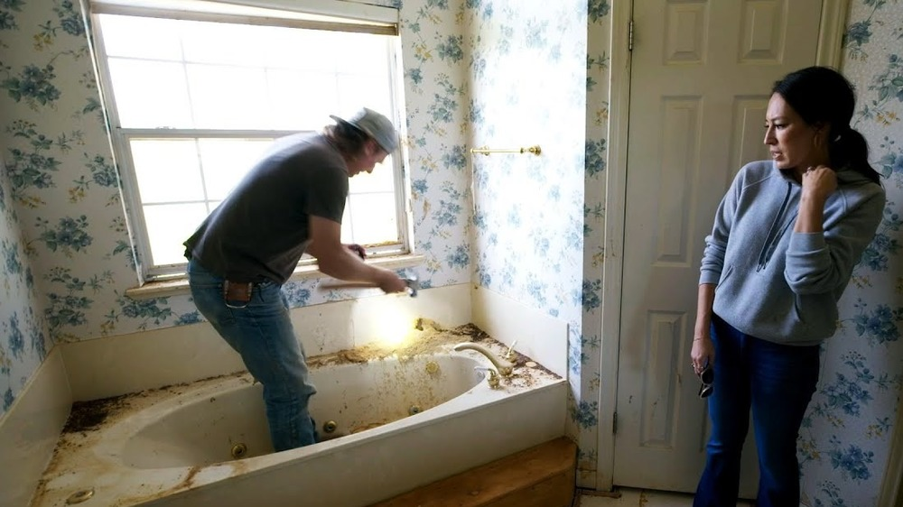 Chip and Joanna renovating a bathroom in Fixer Upper