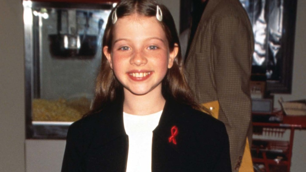 Michelle Trachtenberg as a child, smiling