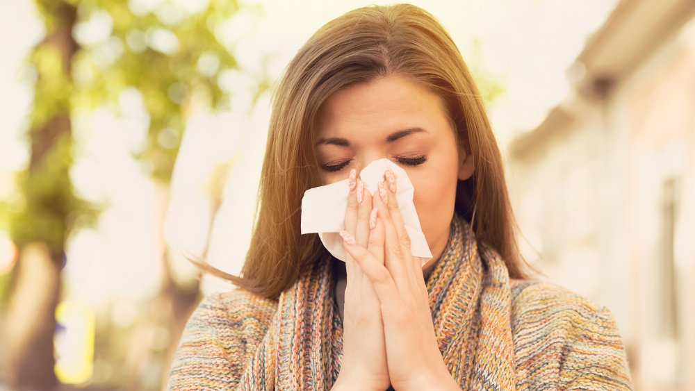 a woman with congested sinuses
